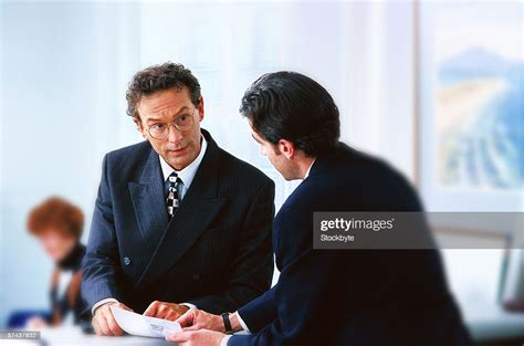 A Bank Teller Talking With A Customer High-Res Stock Photo